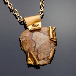 Pendant of Brass and Rhyolite